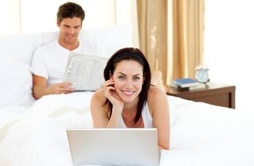 Charming woman using laptop