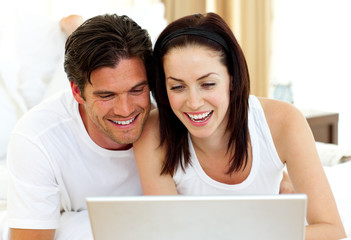 Romantic couple using laptop