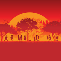 Silhouetted runners in front of city background and sun