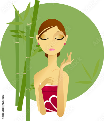 young woman spa on green bamboo background