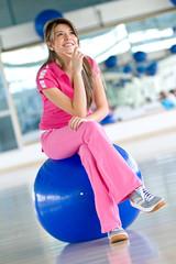 Pensive gym woman