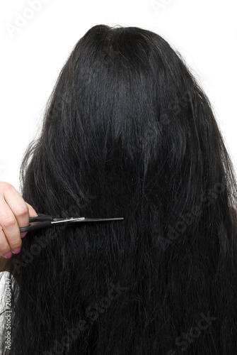 Back of woman long hair and scissors