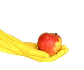 apple on yellow glove, white background