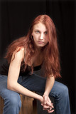 anxious teen redhead seated poster