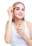 woman applying gel for eyebrows poster