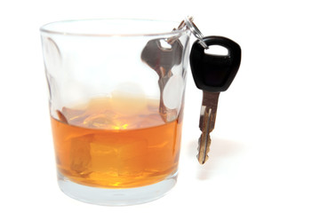 car keys inside whiskey glass