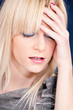 blond woman having headache