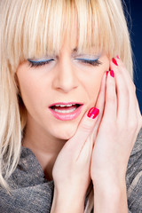 blond woman having toothache