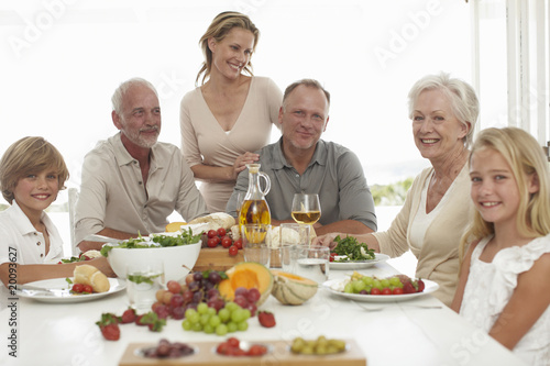 Happy family sitting at a table