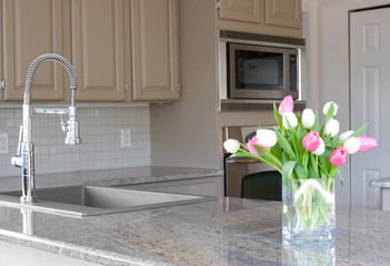 tulips in a modern grey kitchen