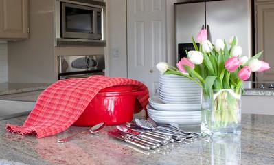 dinnertime - casserole, plates in modern kitchen