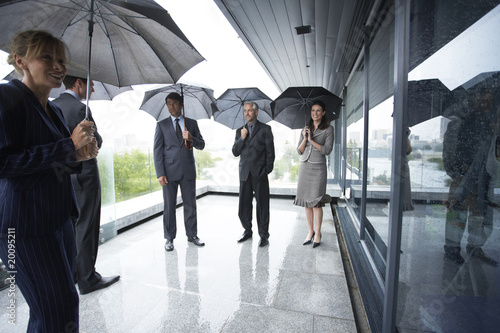 Businessteam with umbrellas