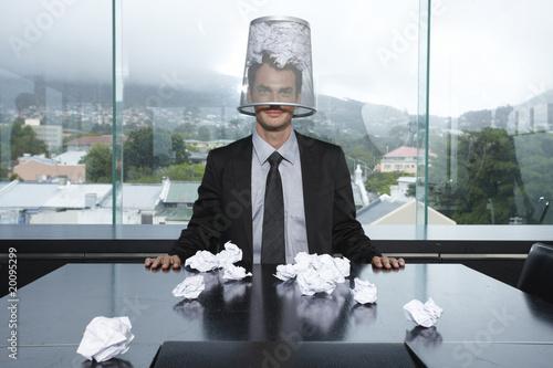 Businessman with a trash box on his head