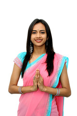 Young Indian in a namaste(greeting) pose