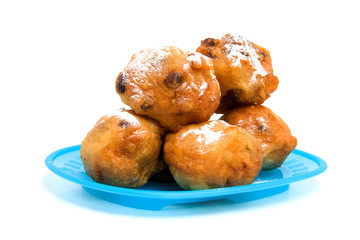 blue plate with Dutch donut also known as oliebollen