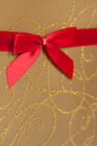 Parcel with gold paper and red ribbon poster