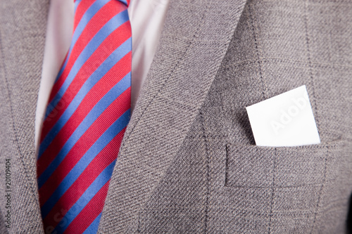 Business card in suit's pocket