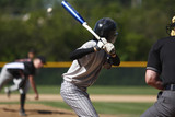 Fototapety batter about to hit a pitch during a baseball game
