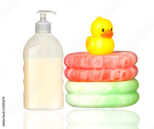 Yellow plastic duck over sponges and boat bath dispenser isolate