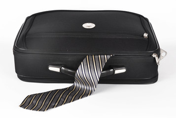 Suitcase with a sticking out tie