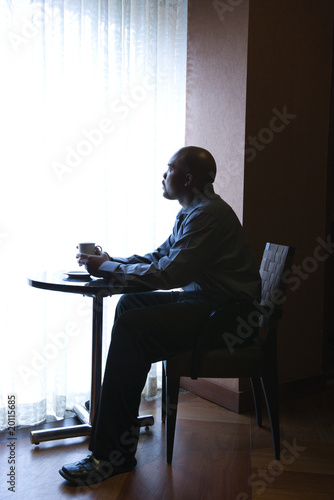 Businessman Sitting by Cafe Window