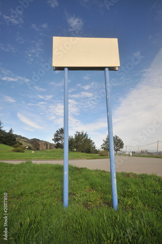 Blank sign held up with two long poles
