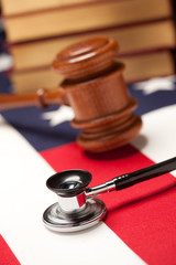 Gavel, Stethoscope and Books on Flag