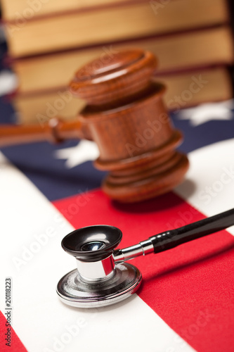 Gavel, Stethoscope and Books on Flag