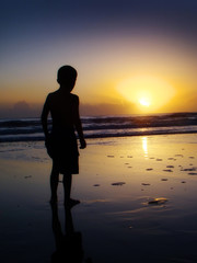 child watching the sunrise in florida