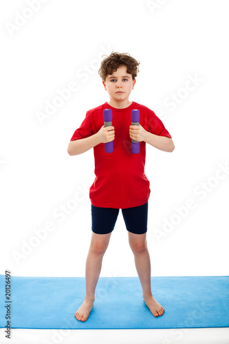 Active boy exercising isolated on white background