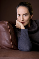Portrait of a mid adult woman sitting in an armchair