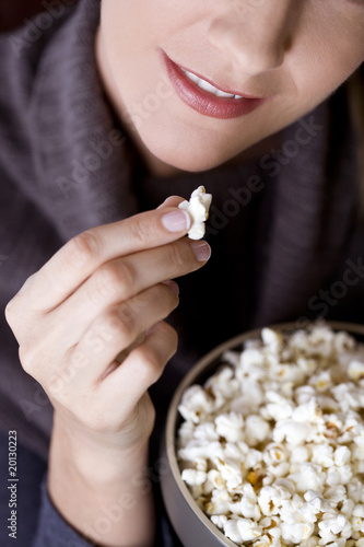 Close-up of a mid adult woman eating popcorn
