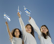 three girls holding the Israeli flags