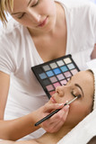 Beautiful Woman Having Make Up Applied by Beautician at Spa poster