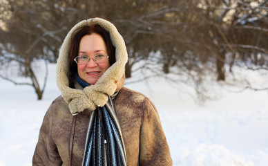 Beautiful middle aged woman enjoying winter day