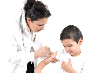 Pediatrician giving an injection in arm to a little boy