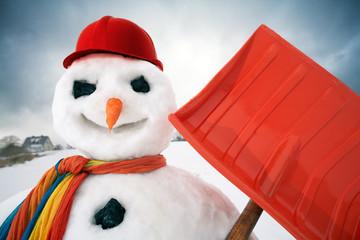 portrait of a friendly snowman with a snow shovel