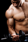 Fototapety Powerful muscular man lifting weights