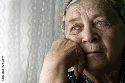 Leinwanddruck Bild Sad lonely pensive old senior woman