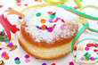 Krapfen or donut with jam and icing sugar