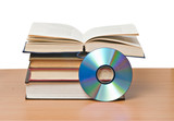 open book  and DVD disk as symbols of old and new methods of inf poster