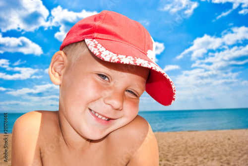 Photo: Portrait of the nice child on seacoast
