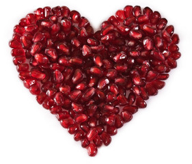eart shaped pomegranate seeds, high key