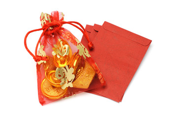 Gold ingots and coins in decorative sachet and red packets