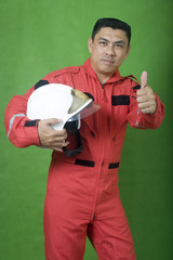 man firefighter holding safety helmet while thumb up