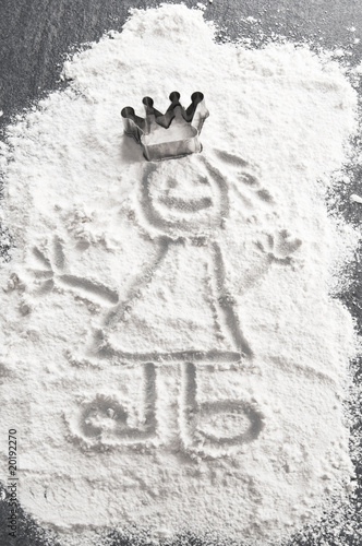 Princess in flour with baking dish crown