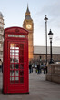 A  typical red phone booth in London with the Big Ben in the bac