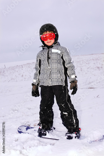 little boy with snowboard