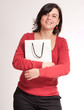 Cheerful brunette with shopping bag