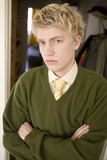 portrait of blond young man in green  pullover poster